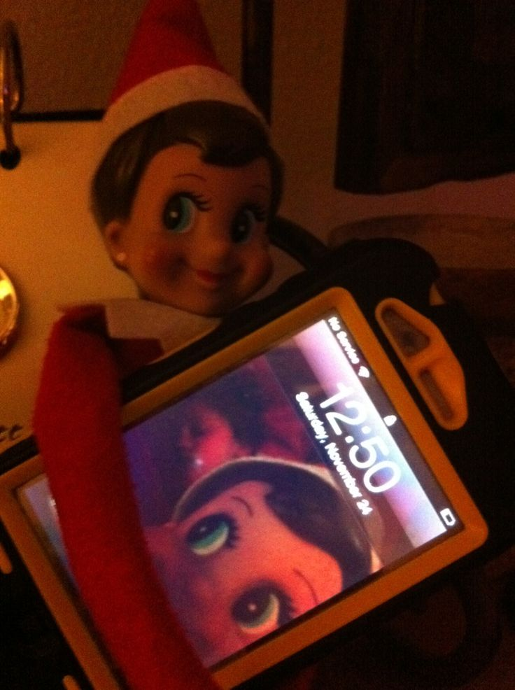 Elf on the shelf taking pictures. Get picture of sleeping kid in the background