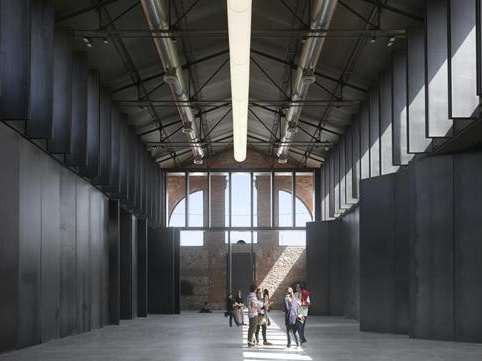 CONTEMPORARY ARTS CENTRE BY ICA ARQUITECTURA, MADRID, SPAIN. This project adapts a large industrial building into a forum for cultural activities. The remodelling concept is based on a system of double-height steel-pivoted doors that can be adjusted to define and enclose different sorts of space − for instance, a neutral void for art installations, or a hall for concerts and performances.