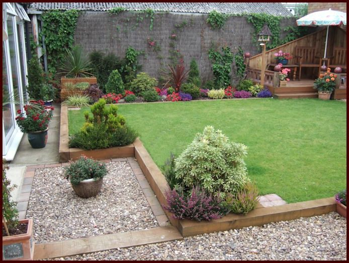 Interesting idea. Raise the grass level and keep the path lower down using railway sleepers