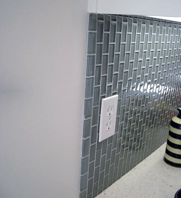 a nice straight grout edge can be created by laying down a strip of 2
