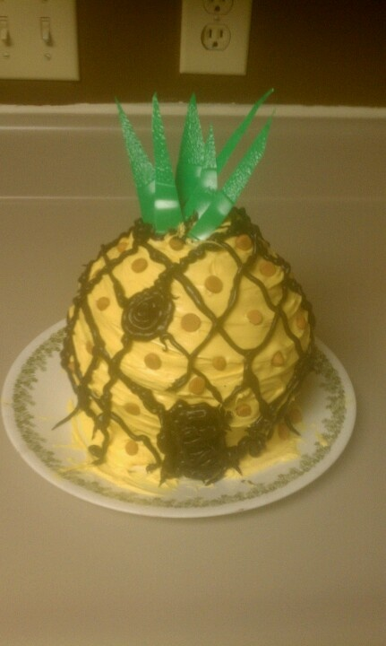 Spongebob pineapple bikini bottom cake from silicone big top cupcake pans. 2 cake mixes 2 cans icing yellow food coloring black icing from can with tip and butterscotch morsels to create pineapple effect.