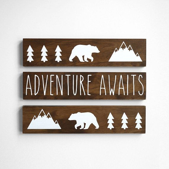Adventure Awaits! This SET OF 3 signs makes the perfect addition to a woodland or outdoor themed nursery! Great baby shower gift for outdoor loving parents! ► SIZE- each sign measures: Height: 3.5 inches Length: 16 inches  ► DETAILS: - 3 solid pine wood signs - Dark walnut stain - Choice of white vinyl or hand painted with white paint - Sealed with a matte finish for protection - Ready to hang! Sawtooth hangers are installed in back of signs  View more from our Woodland Collection…