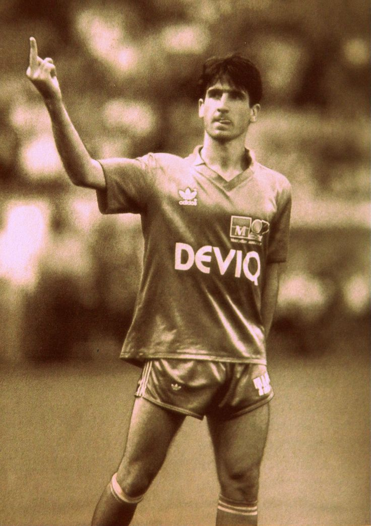 Eric Cantona, with a purely Cantona gesture.
