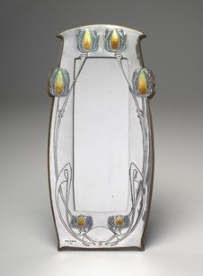 Exceptional Art Nouvean mirror by Archibald Knox (British, 1864-1933), ca. 1902-03, Silver, Enamel, wood, and mirrored glass. Virginia Museum of Fine Arts, Richmond, Virginia