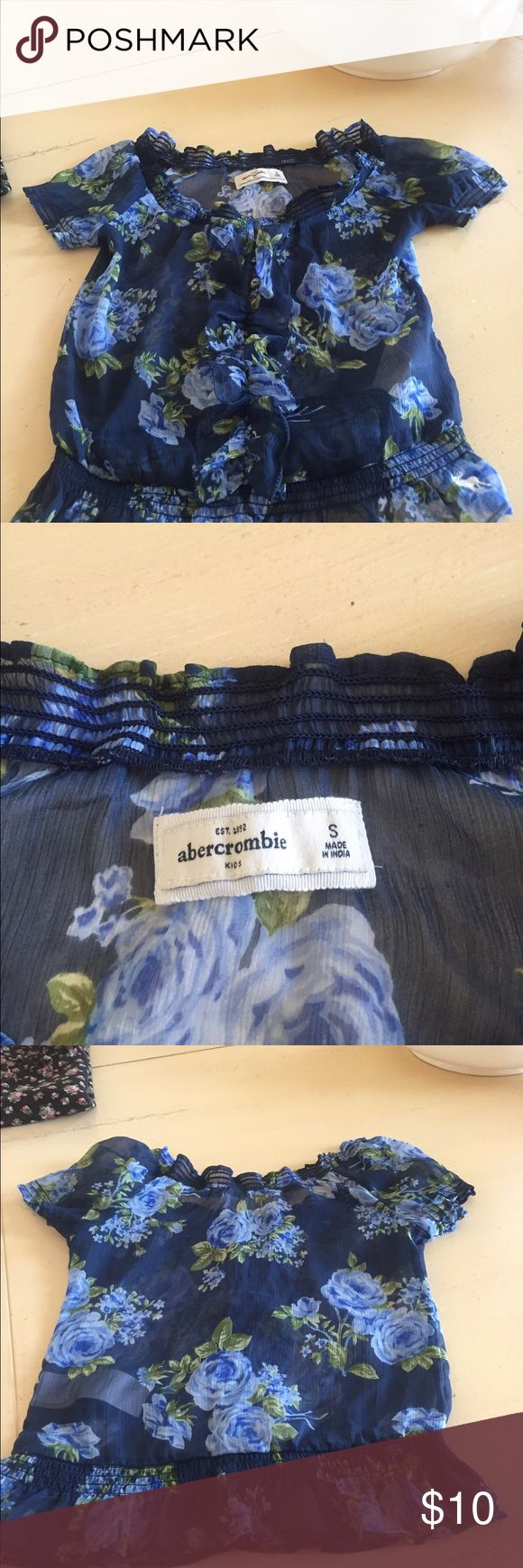 Beautiful Abercrombie girls blouse Navy blouse with light blue and green flowers. Girls small 100% polyester. Need to wear a tank underneath because it is very sheer. abercrombie kids Shirts & Tops Blouses