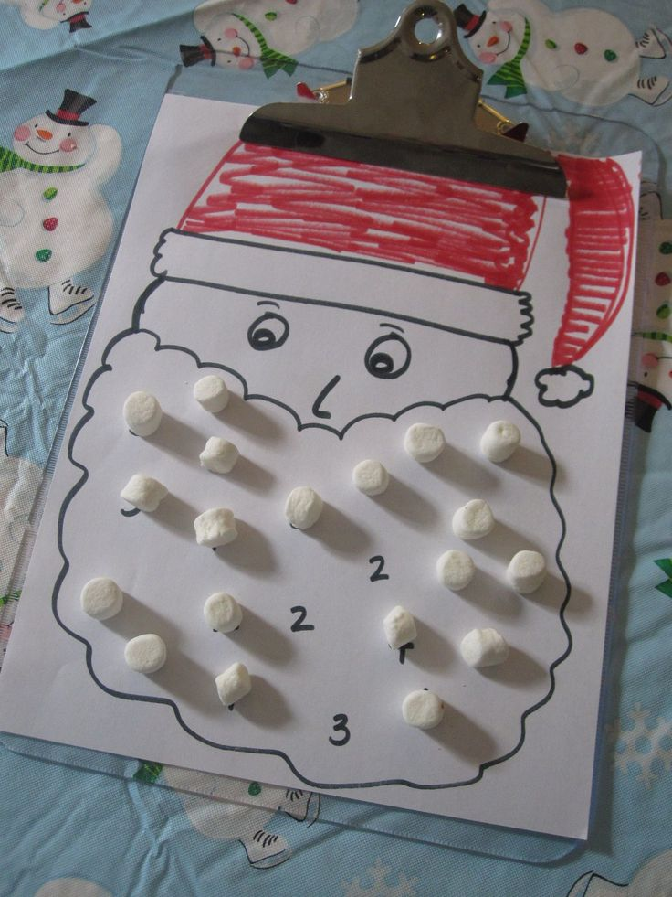 Math Game for Christmas: roll the dice and cover #s on santa's beard with mini marshmallows