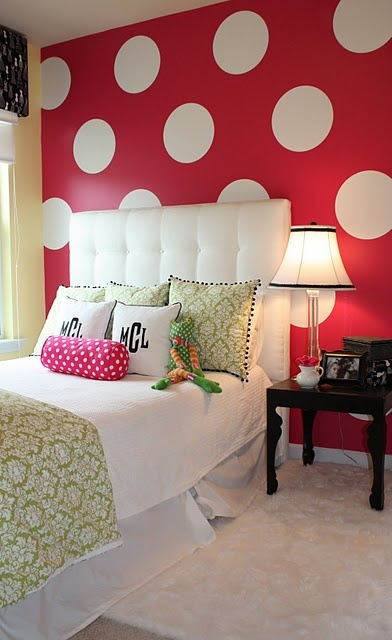 Little girls room: Love the bold wall! Would never have thought of a red wall with big big white polkas, but everything else is so simple that it's not too much...very cute!