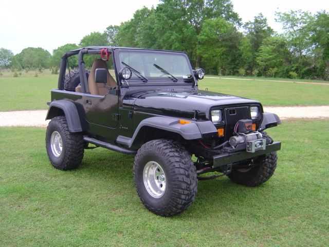 1995 Jeep Wrangler... minus the square headlights she's pretty much perfect