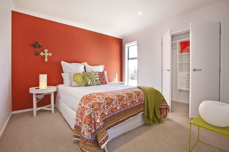 This bright orange feature wall acts to signify this as a separate space from the rest of the house.