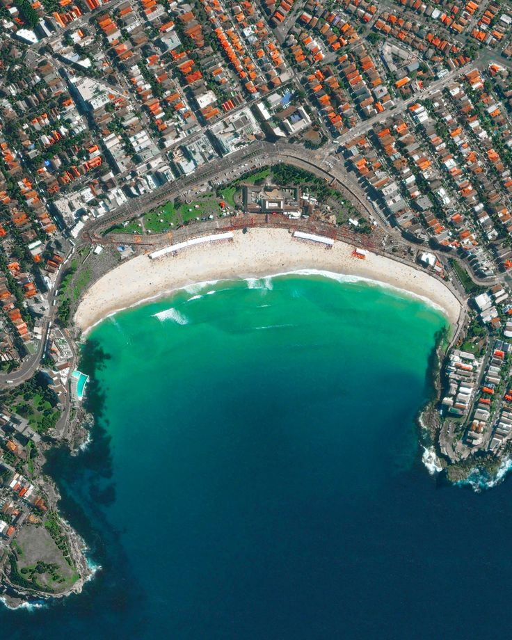 """dailyoverview: Bondi Beach and its surrounding suburb are located in Sydney, Australia. One of the city's most stunning and popular destinations, the beach gets its name from the Aboriginal word """"Bondi"""" that means waves breaking over rocks.33°53′28″S 151°16′40″Ewww.dailyoverview.com"""