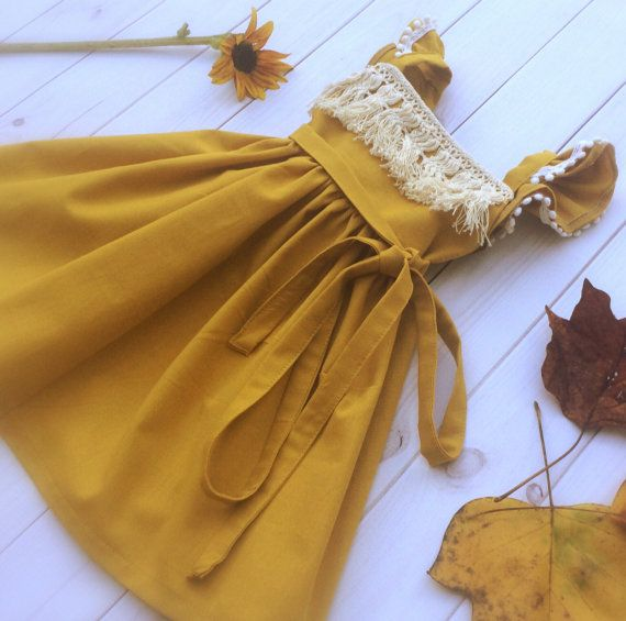Mustard Fringe Dress - fringe dress - fringe boho dress - fringe toddler dress -baby girl dress - mustard girls dress - boho toddler dress  Straps tie into the back giving adjustability and longevity to this little dress. Easy to layer on cooler days.  Would look adorable in fall photos or at Thanksgiving dinner. Shown here with poms on the flutters. If you would like the poms, please select pom trim in drop down menu.  Need a bigger size? Please send me a convo and Ill set up a custom…