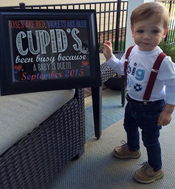 "Amanda Hughes of Charlotte, North Carolina, set up a creative poem in a framed dry erase board next to her 17-month-old son Aiden to make her huge announcement on Valentine's Day. ""Aiden was an IVF baby and we had a less than 2 percent chance of getting pregnant on our own,"" says Amanda, who submitted this photo to Parents' America's Best Pregnancy Announcement contest. ""Needless to say we were in shock and surprised to be pregnant. Cupid sure was busy!"""