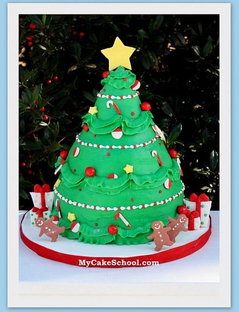 Christmas Tree Cake from a MyCakeSchool.com video tutorial ;0) - Buttercream with fondant accents!