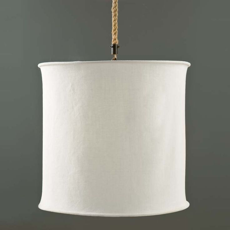 """A simple white canvas is the hallmark of this Stany Chandelier from BoBo. A classic pendant light is re-invented when BoBo pairs a simple white Belgian linen and a classic drum shade to make this slightly rustic pendant. When suspended from heavy 27"""" rope with hooks, this pendant is sure to stand out from all the rest. **NOTE: BoBo Intriguing Objects Chandeliers and Pendants are imported and DO NOT INCLUDE a canopy or chain.** Please note that items from BoBo Intriguing Objects are imported…"""
