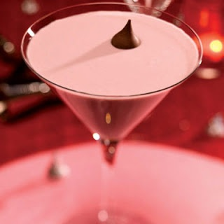 French Kiss  30mL Chambord   30mL vodka   30mL dark crème de cacao   45mL Light Cream  Hershey's Kisses  Directions:  Shake ingredients with ice and strain into a cocktail glass, top with a Hershey's Kiss #cocktail
