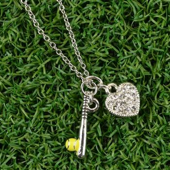 Love Softball? This beautiful necklace is perfect for the passionate softball player. This necklace features two charms that include a silver and enameled bat and ball charm and a beautifully crafted Czech glass rhinestone heart.