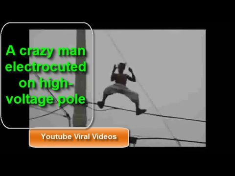 A crazy man electrocuted on high voltage pole