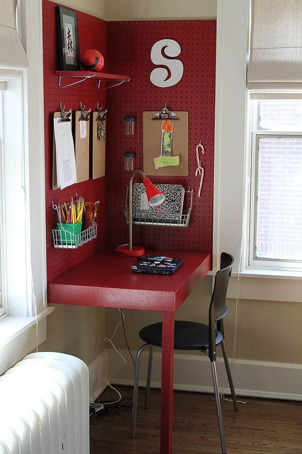 Clever way to carve out a corner micro work space... love the peg board and color!