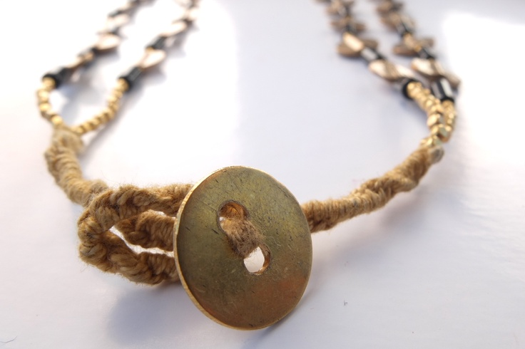 Coin as clasp for a necklace made of fine glass w/ cute brass coins.