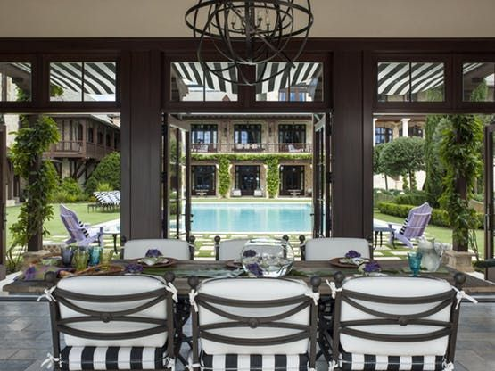 Black and white striped awnings and cushions in Sunbrella fabric bring a taste of the Cote d'Azur to an outdoor seating area  Outdoor Room  Solarium  Contemporary  French Provincial  Transitional by Taylor & Taylor