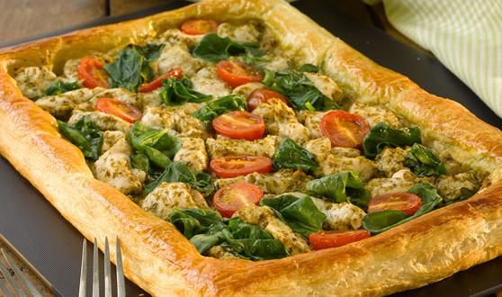 Chicken, Pesto and Spinach Puff Pastry Open Tart - I love doing this type of open tart. It is creative as well as quick, and is easy to make and portion for visitors. You can toss many different things on top, sweet and savoury, simple or complex. Tomato, peppers and pesto with fresh basil leaves, or cooked apples or pears with cinnamon and sugar. For a snack I top the pastry with canned tuna, garlic and herb salt, and dollops of my wife's red pepper relish.