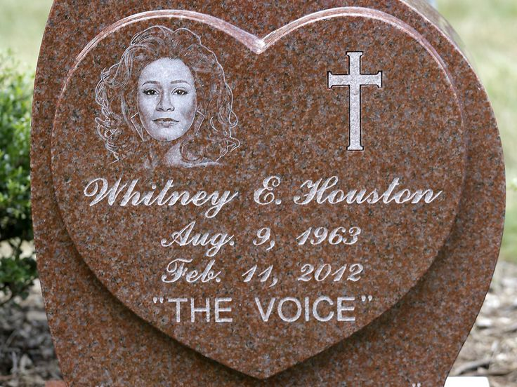 Whitney Houston's gravestone revealed, reads: 'I will always love you' (Photo: Julio Cortez / AP)