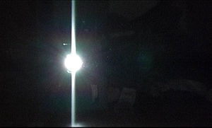 """ENGINEERING: As a light-gathering pixel exceeds its capacity to hold captured photons, the excess energy spills over into the adjacent pixel (or pixels, if the second pixel also fills to its capacity). This spillover, called """"blooming,"""" produces a spike of light on every bright star in the image.  https://www.astronomics.com/blooming_t.aspx"""
