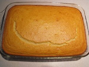 """corn bread in a cake pan.  so moist and yummy! - made it this week and this will definitely be my """"go-to"""" cornbread recipe from now on. Mike loved it too. It's easy to make and literally the moistest cornbread I have ever had....delicious! When you make it try it with some butter and honey on top right out of the oven!"""