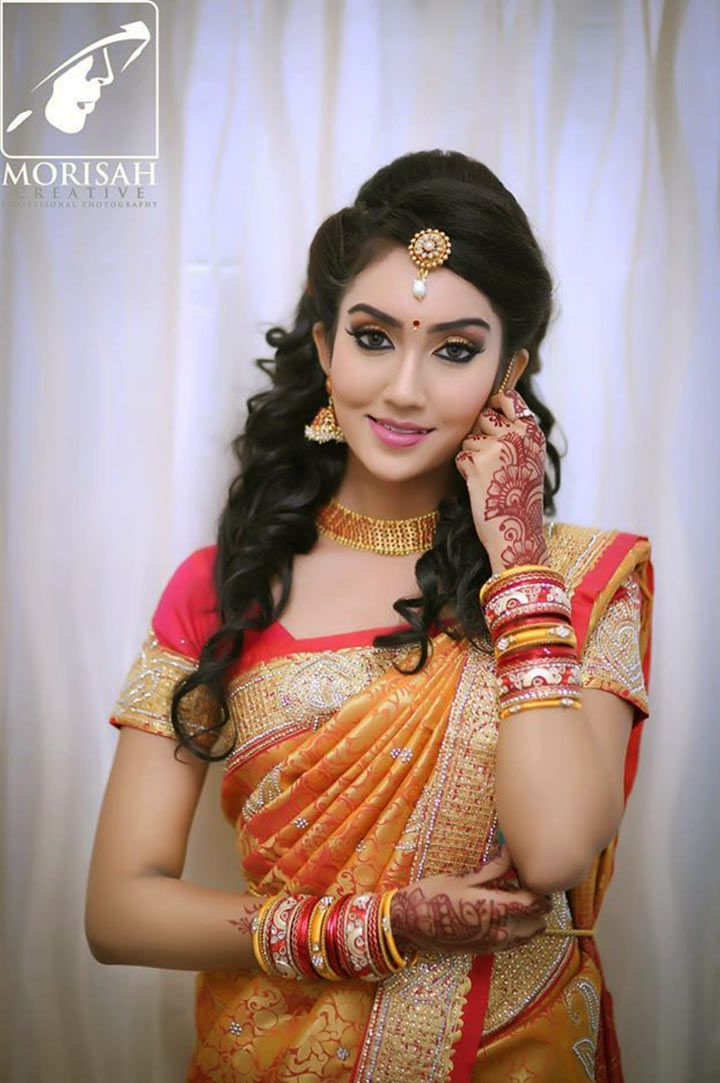 South Indian Bridal MakeUp With An Off Beat Hairdo