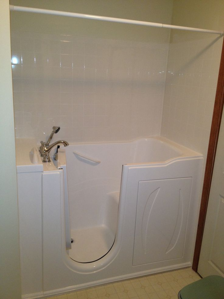 Serenity walk in bathtubs come with an adjustable shower for Sit down shower tub