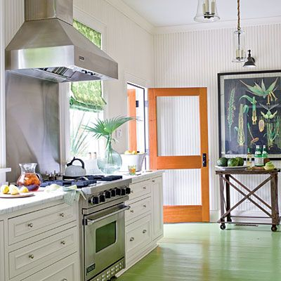 Tropical Kitchen: The floor is painted a leafy green, which will give an even more weathered, beachy feel to the kitchen when the boards start to show through. Vintage-inspired beaded board lends even more character to the room while the white keeps it fresh and crisp.