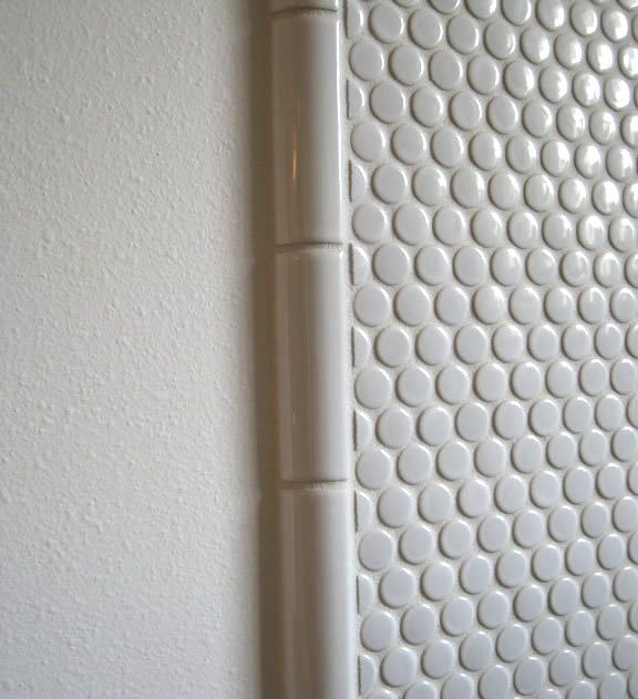 Edging ideas from Modwalls. 1/4 round tiles used as edging (edging tiles readily available at hardward and home stores).