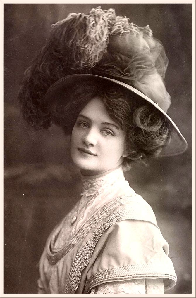 Vintage Gibson Girl Photo. They didn't wear much make up but I love the way they look!