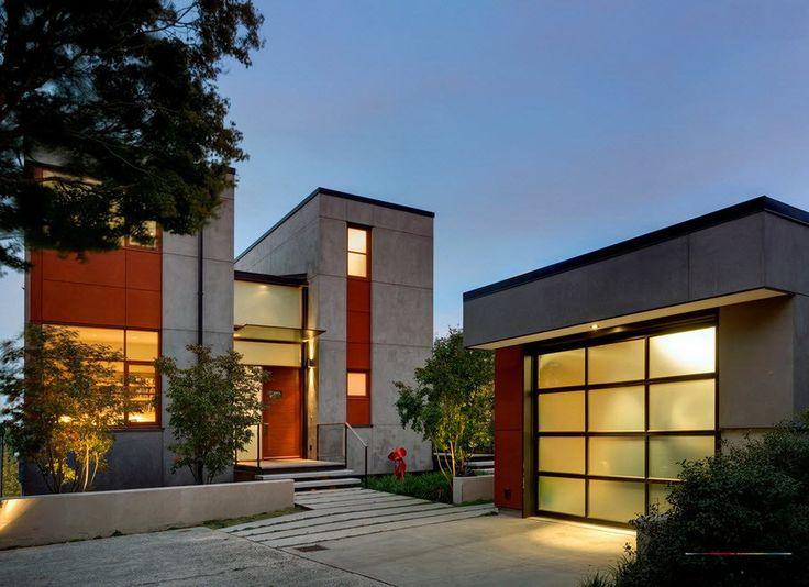 Contemporary House With Modern Frosted Sectional Garage Design