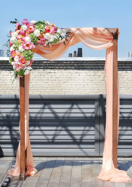 peach wedding ceremony arch by Jolly Bunch / http://www.himisspuff.com/wedding-arches-wedding-canopies/4/