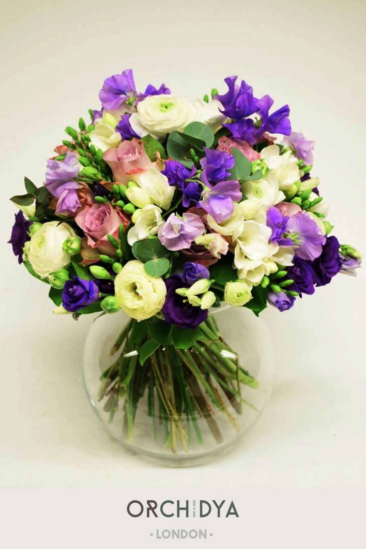 Purple Yellow And Green Are The Ultimate Spring Colours They Look Simply Perfect In Artificial Flower Arrangements Fresh Flowers Arrangements Flowers Bouquet