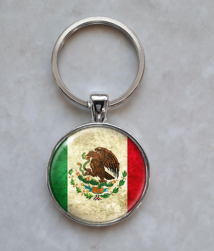Bandera de Mexico Keychain. Welcome, up for sale is this beautiful handmade pendant Keychain. Dimensions: You can choose between a Pendant that is 25mm in diameter (about 1 inch) OR a pendant that is 40mm in diameter ( about 1.5 inches). The smaller key ring (split ring) measures about 25mm in diameter and the larger key ring measures 35mm in diameter. Materials: The pendant and key ring (split ring) is made out of a metal alloy. The pendant encompasses a printed image. This image has…