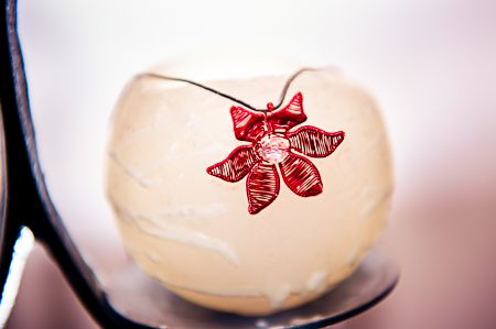 Wire Art Jewellery: Red wire flower pendant by Sarah Jansma