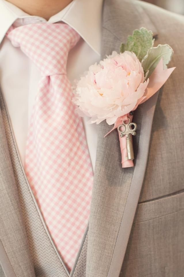 I love the light color suit with pink accents. Would be perfect for a spring or summer wedding! The key on the boutonniere is a lovely touch!