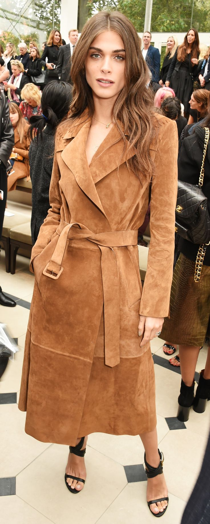 Elisa Sednaoui wearing a suede Burberry trench coat inside the S/S16 show space