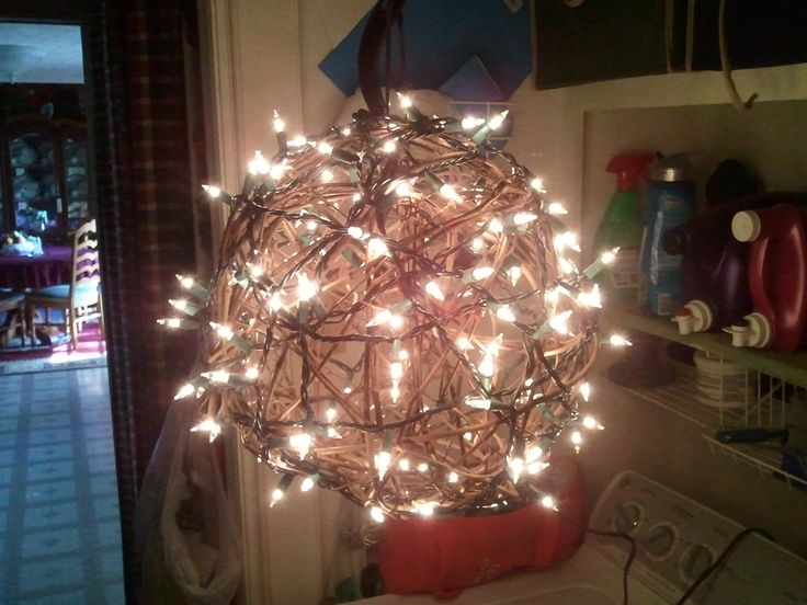 I found this big grapevine sphere and I zip tied old white Christmas lights  to it and made me