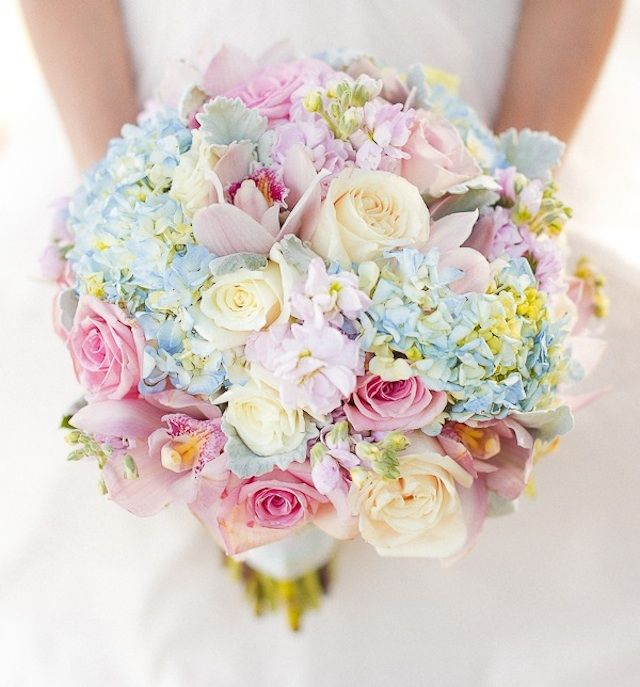 Light pastel bouquet with pops of baby blue and pink..