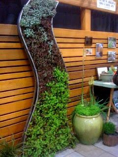 love this modern & soft look for a vertical garden feature.