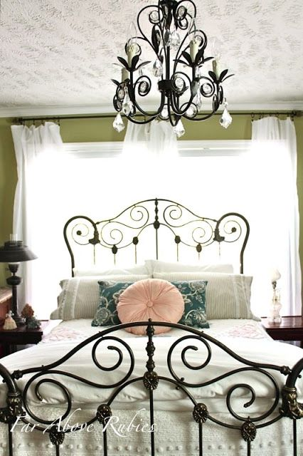 Antique rusted iron bed I restored. Lots of work but worth it:-)