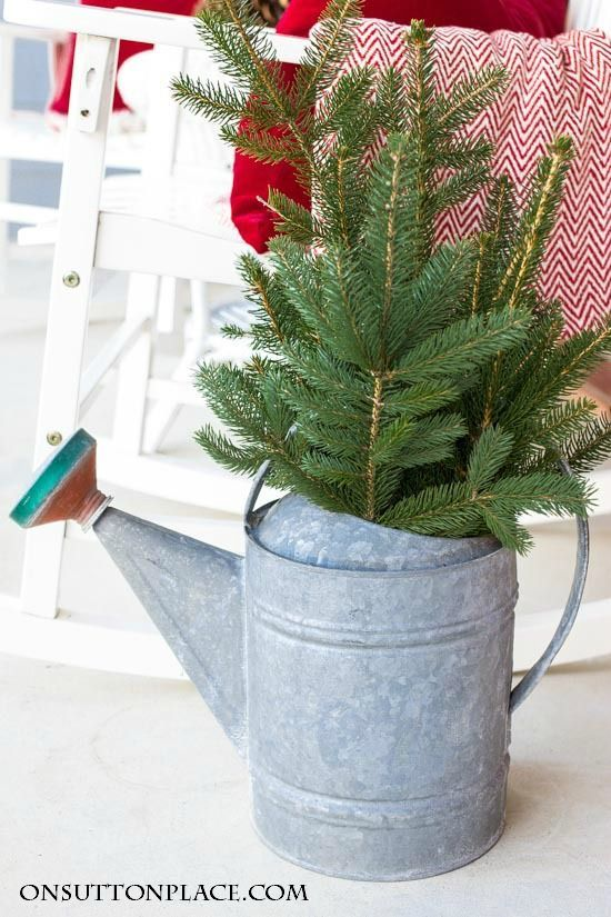 Christmas Porch Decor | Red, Ribbon & Pine | Touches of red, striped ribbon and pine add Christmas cheer to this front porch. Easy ideas to inspire!