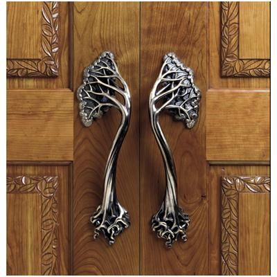 Arts and Crafts styled hardware pulls add an inspired touch to any architectural or craftsman styled home.: