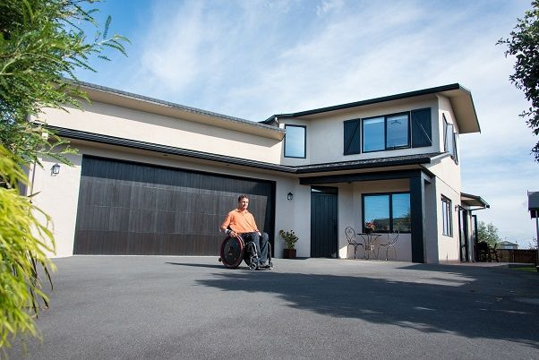 Neil is a tetraplegic architect who designed a new home that would suit his and his young family's needs
