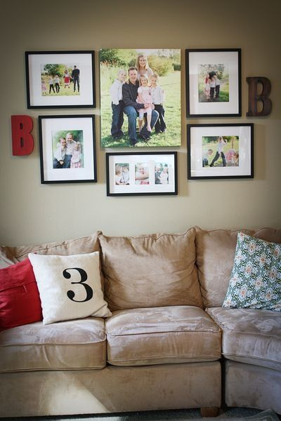 cute family pictures wall. love the two letters and the number