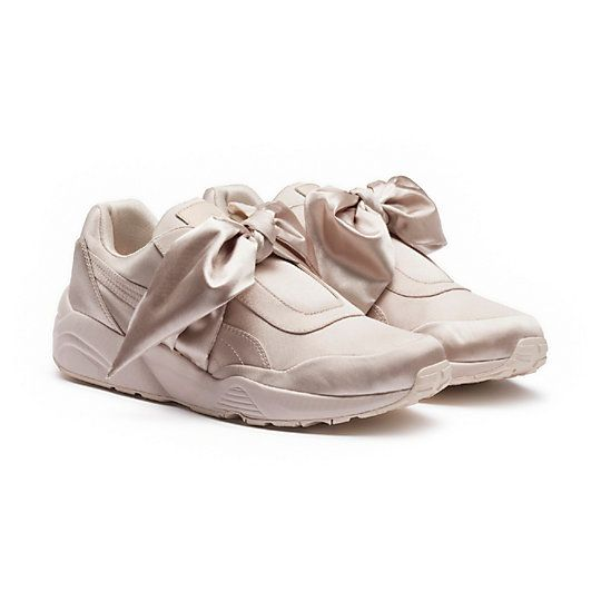 <p>A sneaker for any occasion - the Bow Sneaker takes PUMA's old school running style, the Trinomic, and packs it with a new found punch. All over satin upper with a tonal outsole, the sneaker features a delicate satin bow and the PUMA by Rihanna signature tongue patch.</p><p>Features</p><ul><li>All over satin upper</li><li>PUMA by Rihanna sign off patch</li><li>FENTY PUMA by Rihanna on footbed</l...