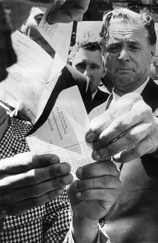 1969: Dr Jim Cairns, Member of the House of Representatives, burns a draft card in the Melbourne Civic Square as part of a protest against conscription for Vietnam. At this stage 325 Australians have died in the war.